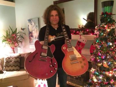 JD Simo at home with his two favorite guitars. (Photo by JD Simo)